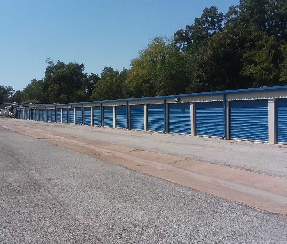 Row of outdoor storage units at AAA Alliance Self Storage in Humble, Texas