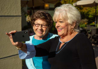 Residents taking a selfie at Merrill Gardens at Green Valley Ranch
