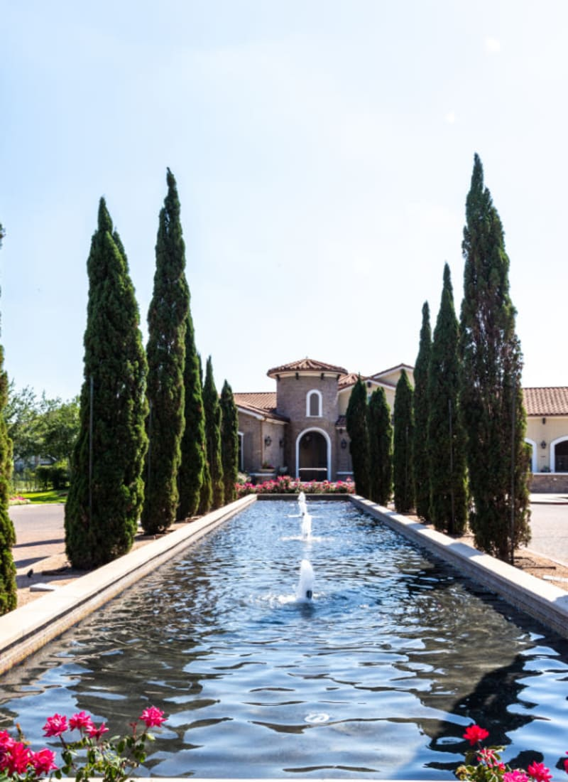 Main property entrance with water feature in center at Marquis at the Reserve in Katy, Texas