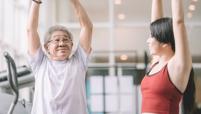 Resident working with a trainer at The Springs at Lake Oswego in Lake Oswego, Oregon
