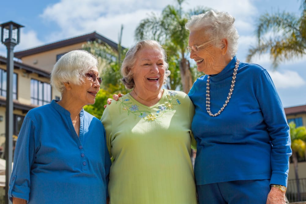 Residents laughing together at our senior living community in Monterey, CA