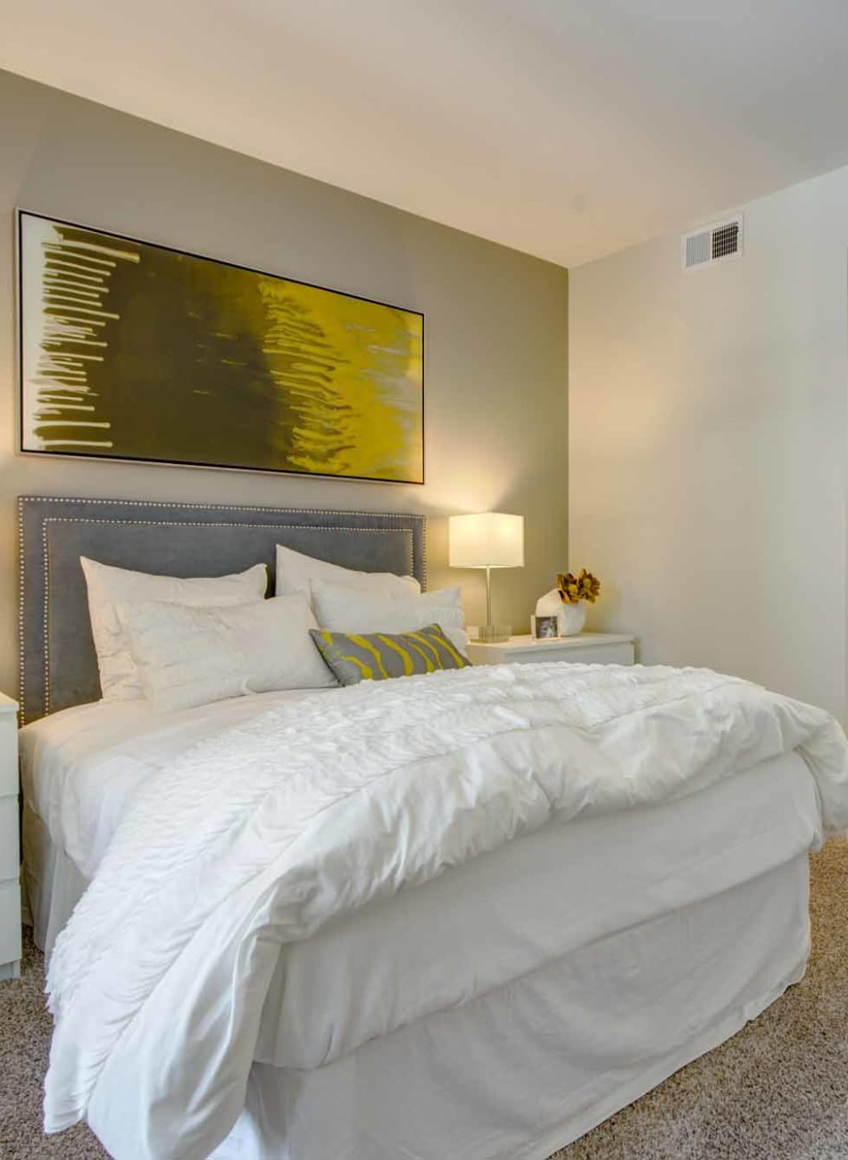 Master bedroom with a walk-in closet at Domus on the Boulevard in Mountain View, California