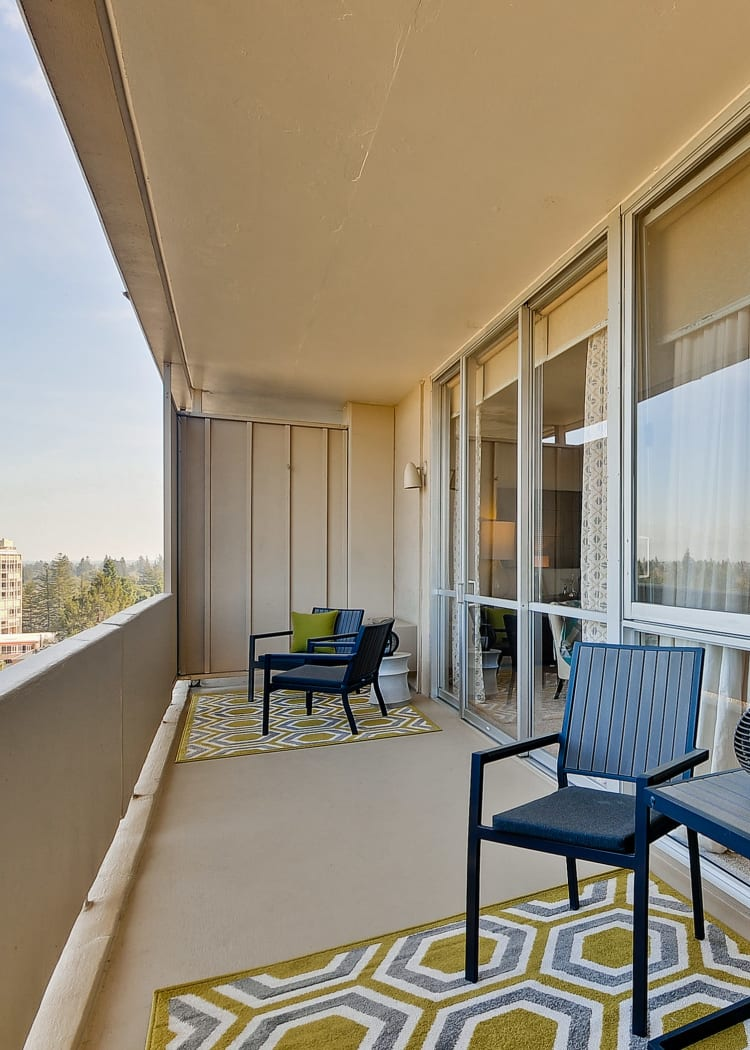 Spacious balconies with treeline views at The Marc, Palo Alto in Palo Alto, California