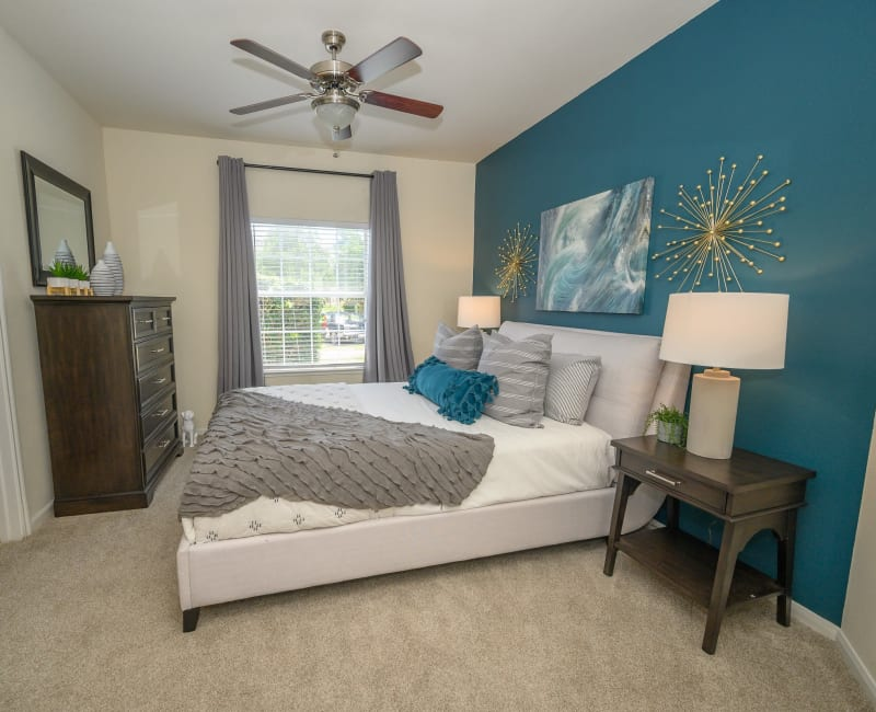 Well lit model bedroom at The View at Lakeside in Lewisville, Texas