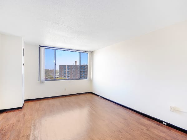 Living room with hardwood floors at Edgewood Commons