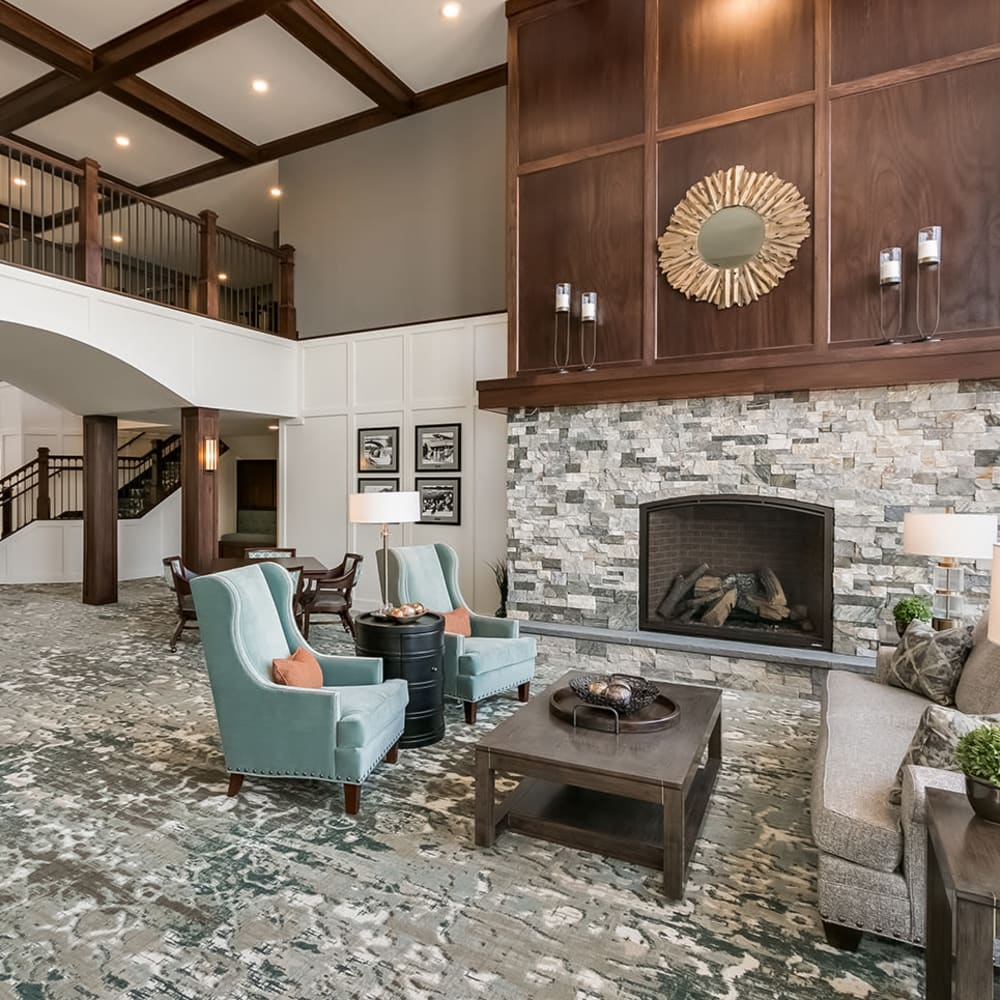 Lobby with a fireplace at an Applewood Pointe community.