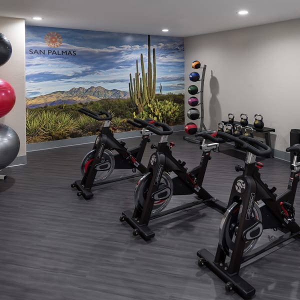 Three indoor spin bikes in gym at San Palmas in Chandler, Arizona