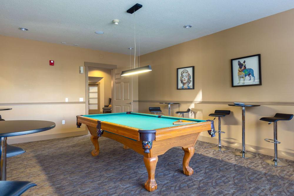 pool table lounge at The Landings at Morrison Apartments