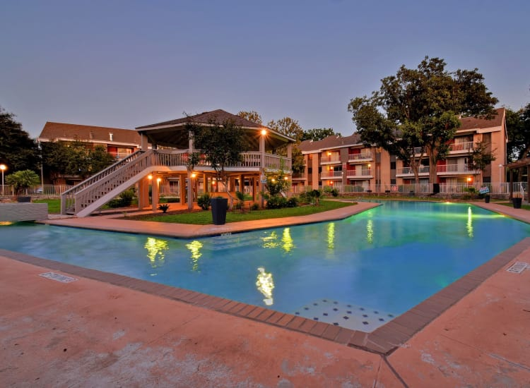 Beautiful pool with gazebo at dusk at Oasis at Oakwell in San Antonio, Texas