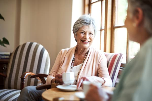 Residents having coffee at The Springs at Lancaster Village in , Oregon