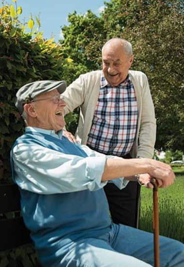 Two older friends sharing a laugh at Burr Ridge Senior Living