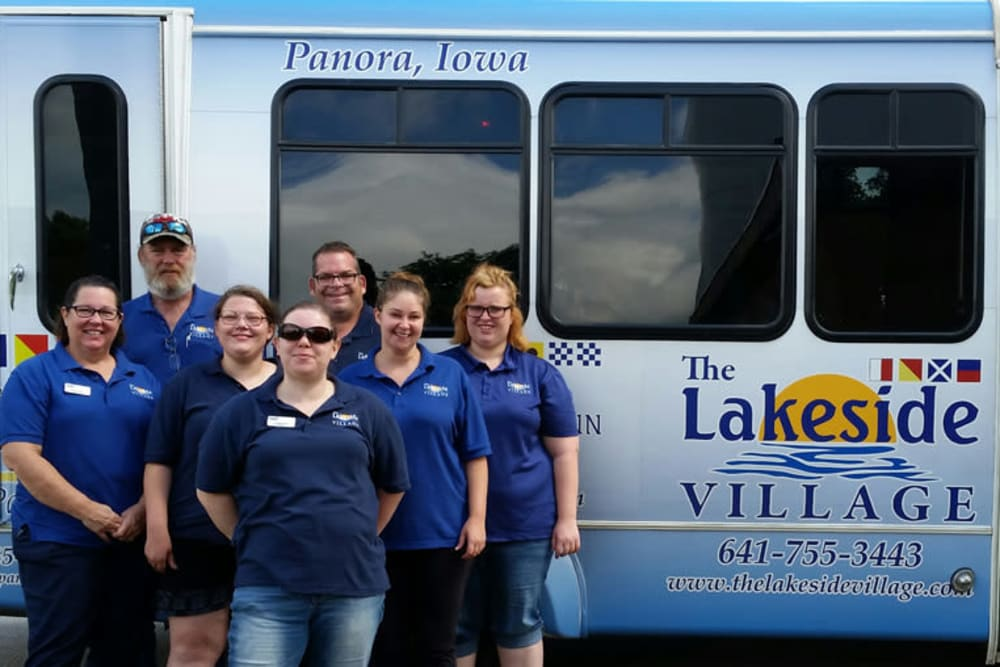 Staff members and the activity bus at The Lakeside Village in Panora, Iowa.
