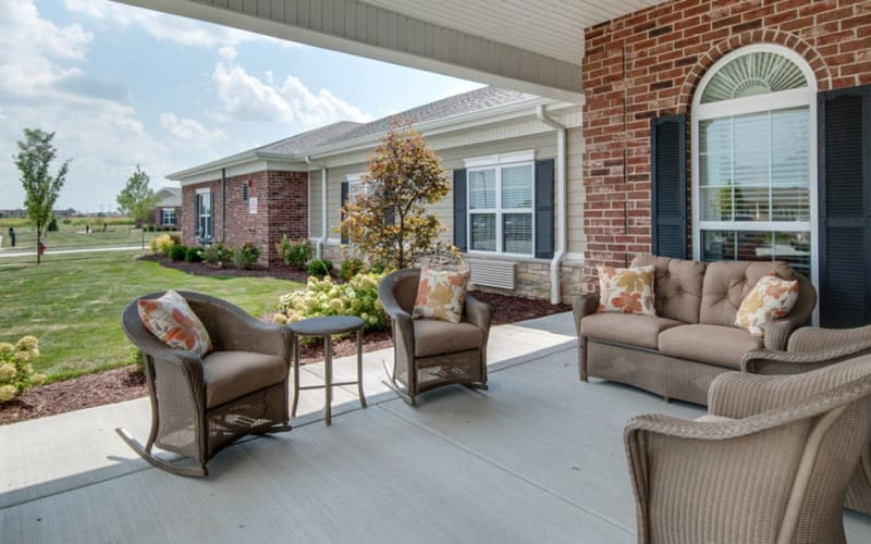 Outdoor patio with chairs at Mattis Pointe Senior Living in Saint Louis, Missouri
