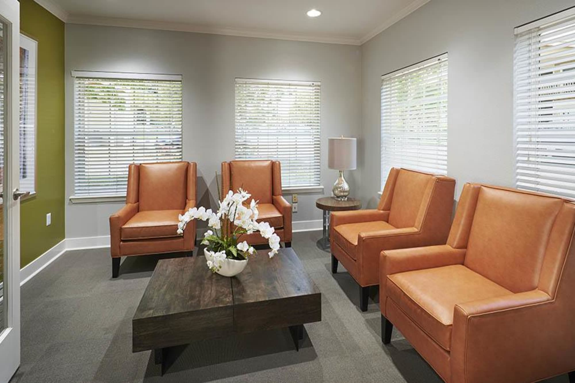 Clubhouse seating area at Crossroads at City Center Apartments in Aurora, Colorado