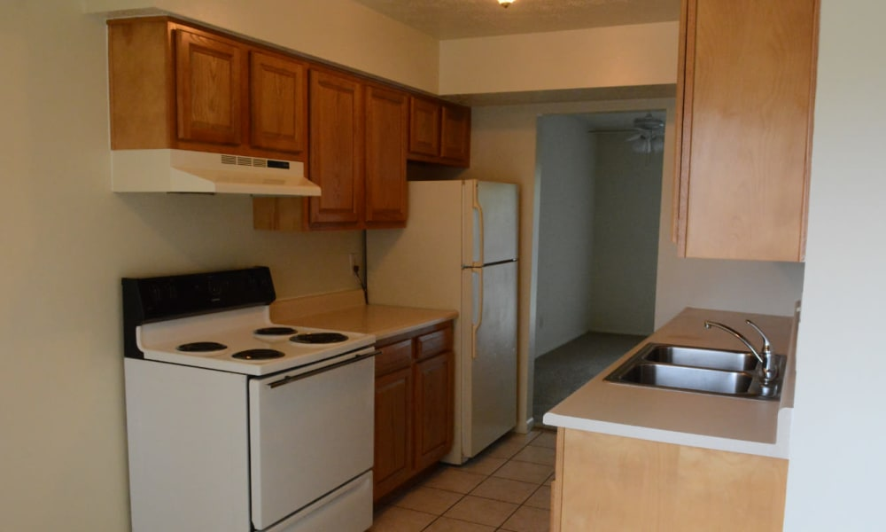 A spacious kitchen with white appliances at Northgate Meadows Apartments in Cincinnati, Ohio