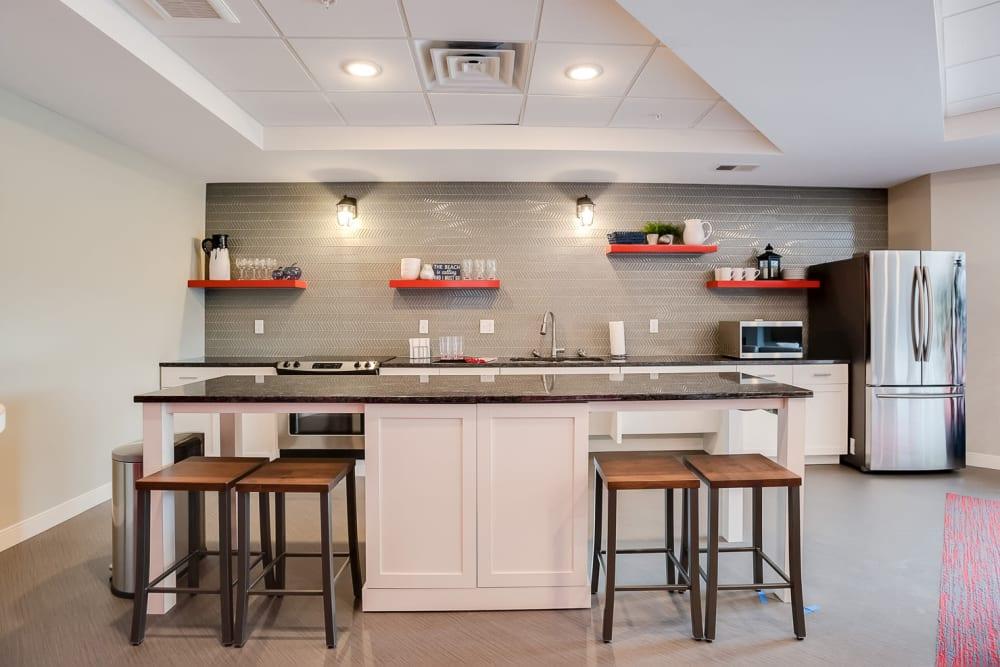 A community kitchen for entertaining guests at Lake Jonathan Flats in Chaska, Minnesota