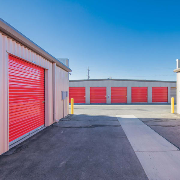 Outdoor storage units with red doors at StorQuest Express - Self Service Storage in Woodland, California