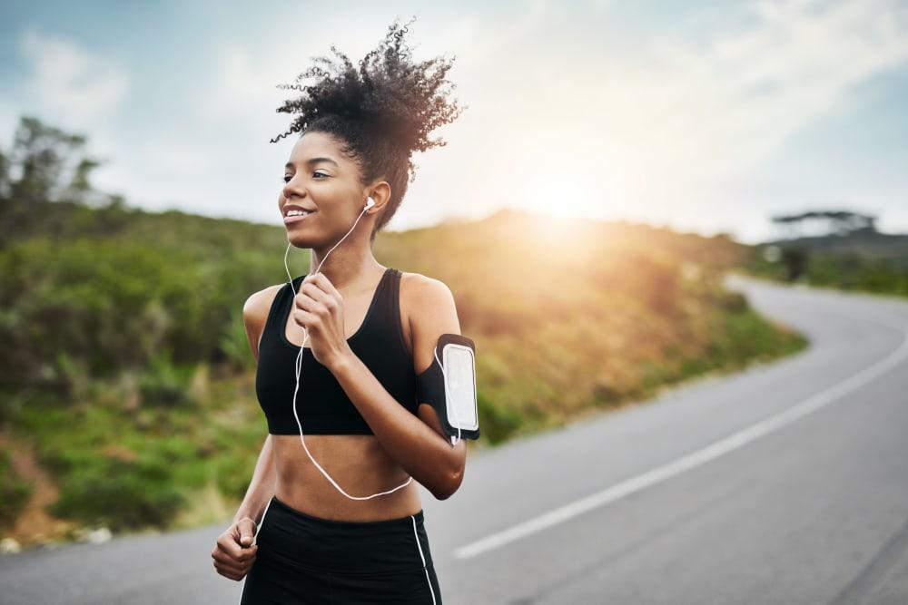 A woman on a jog near Wildreed Apartments in Everett, Washington