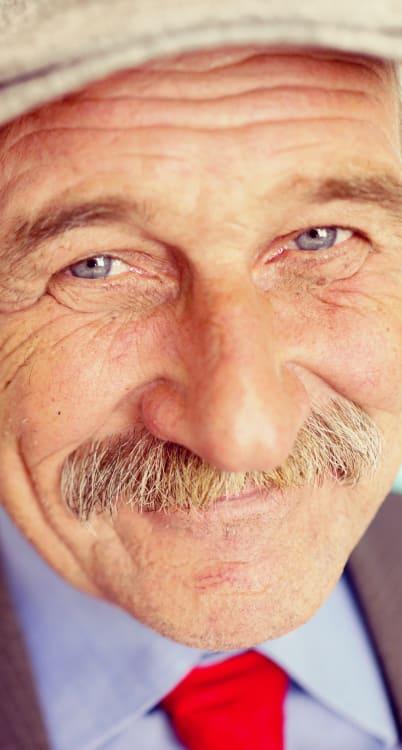 Gentleman in a hat at MuirWoods Memory Care in Petaluma