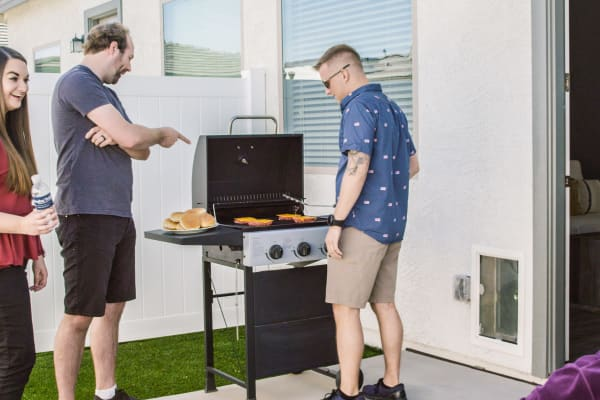 Residents grilling at Christopher Todd Communities At Stadium in Phoenix, Arizona