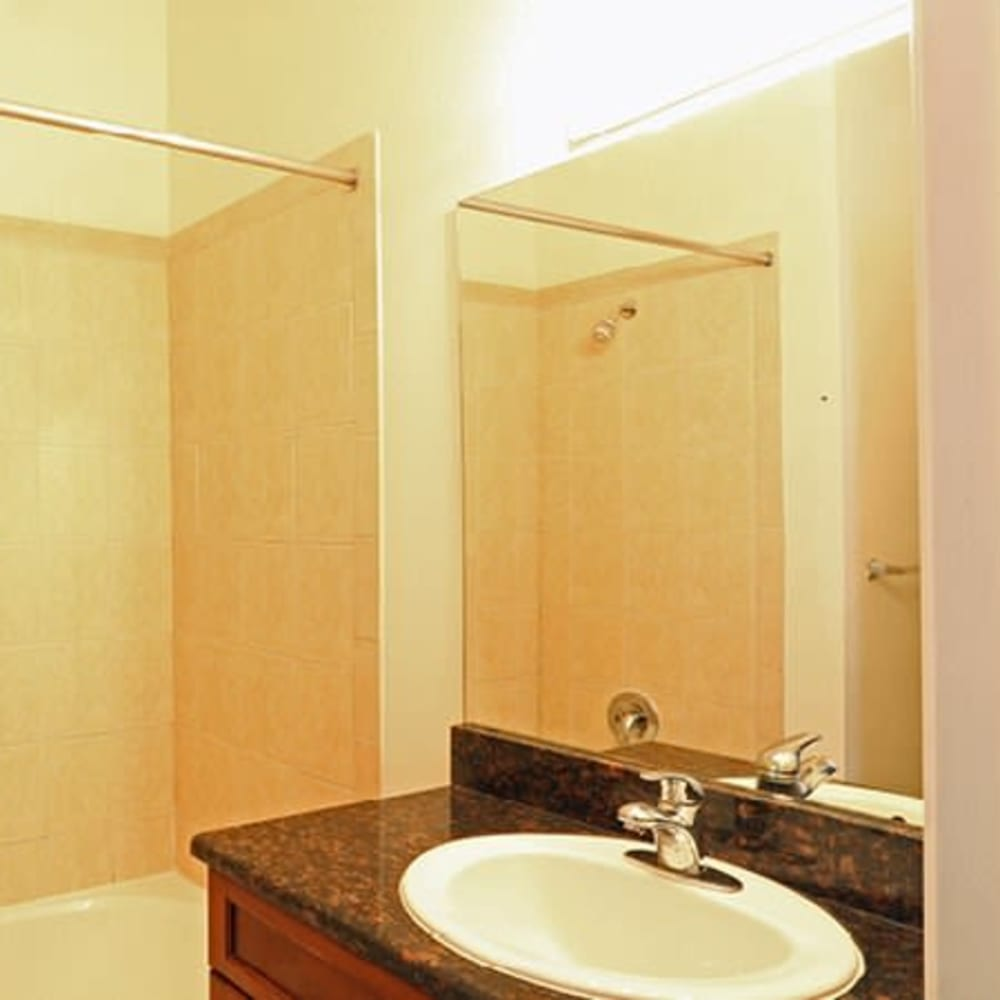 A bathroom with an oval tub at Town Park Villas in Tampa, Florida