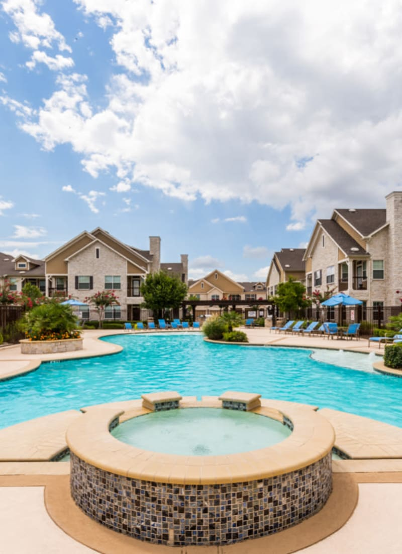 Hot tub and pool area at Marquis at Cinco Ranch in Katy, Texas