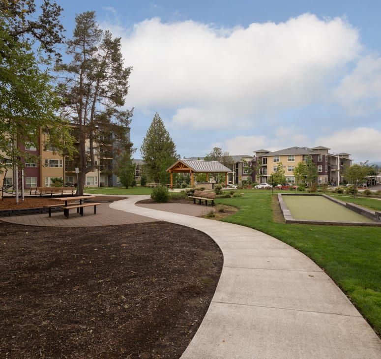 Exterior photo of homes and a walking path at Terrene at the Grove in Wilsonville, Oregon