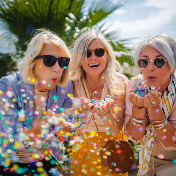 Residents blowing confetti at The Atrium at Carmichael in Carmichael, California.