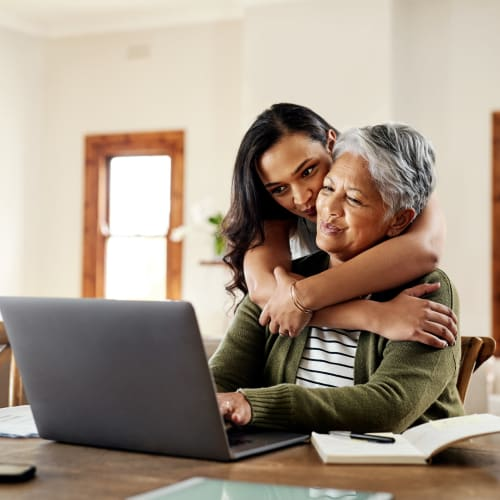 A women and her mother renting a unit online from San Diego Self Storage