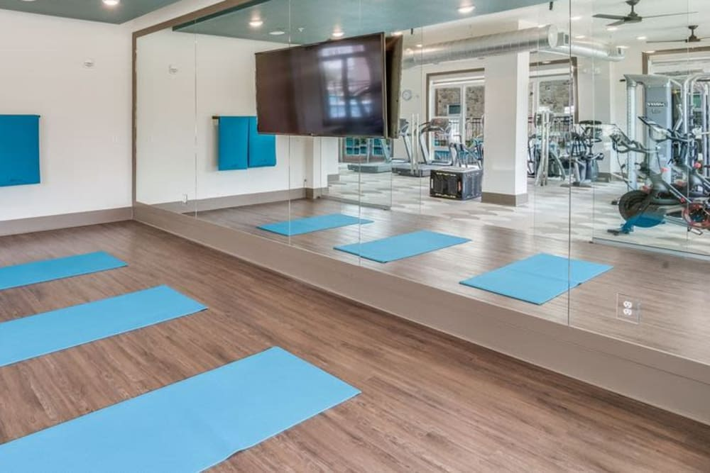 24/7 Fitness center at Enclave at Woodland Lakes in Conroe, Texas