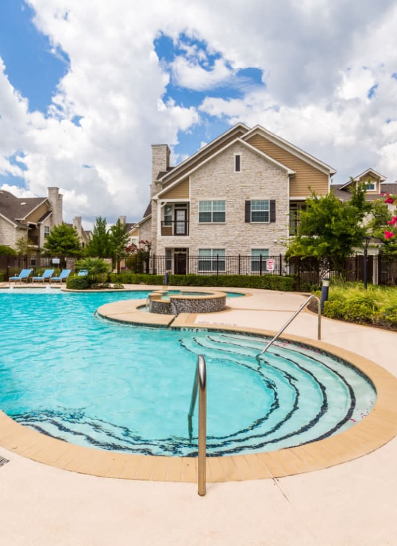 Poolside lounge area at Marquis at Cinco Ranch in Katy, Texas