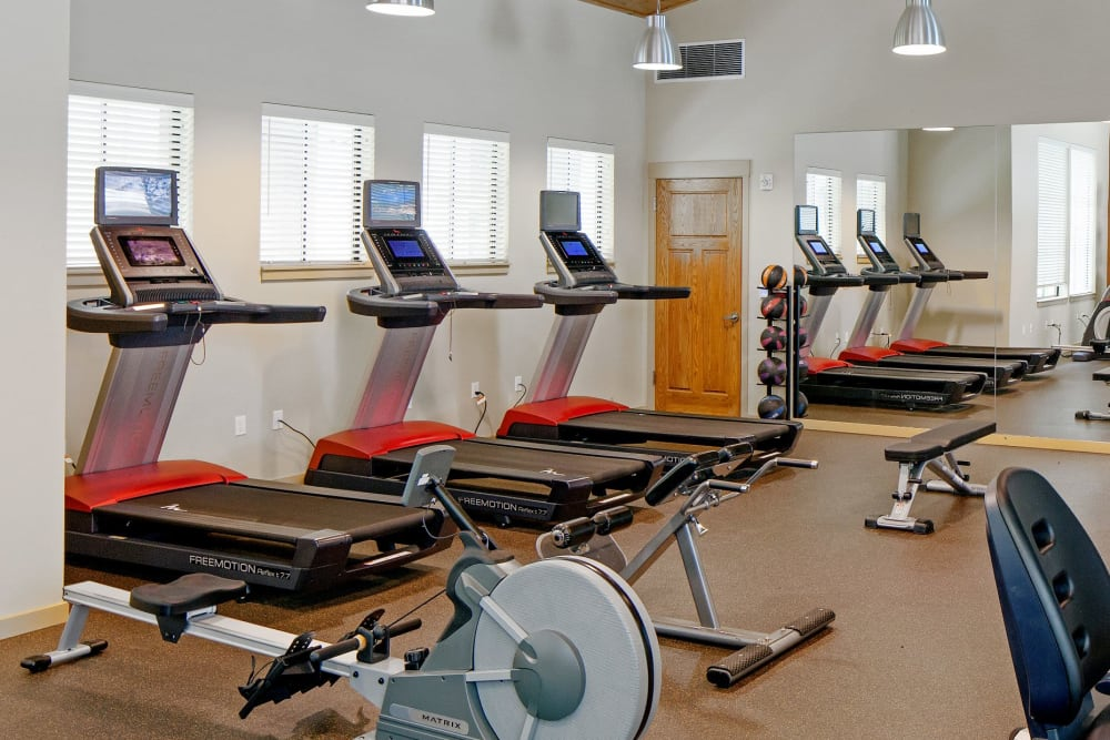 Fitness center with plenty of workout stations at Eddyline at Bridgeport in Portland, Oregon