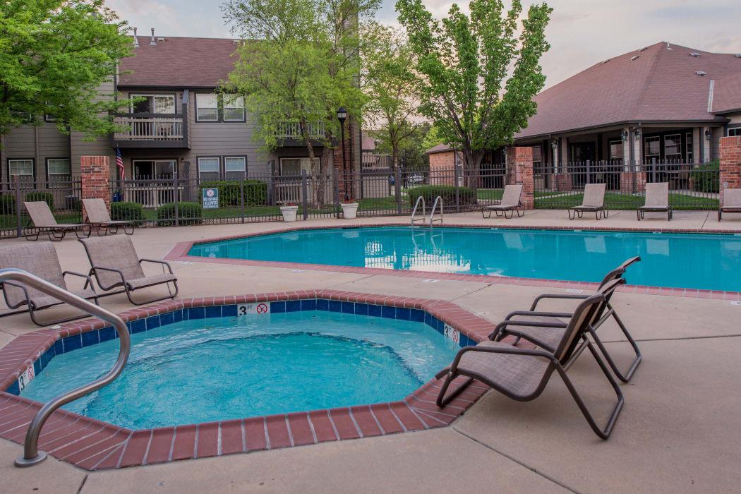 Swimming pool and hot tub at Huntington Park Apartments in Wichita, Kansas
