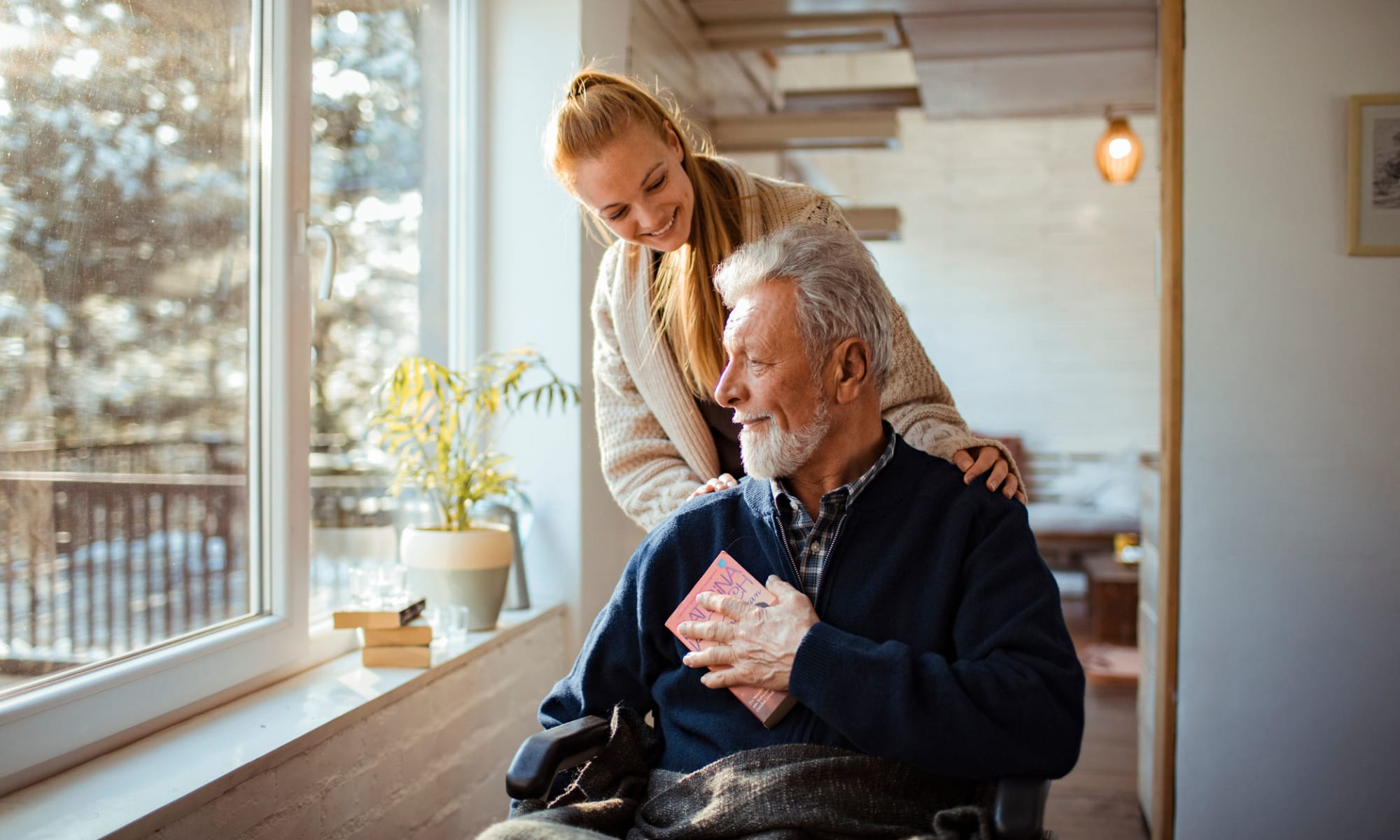 Caregiver assisting a senior gentleman at Broadwell Senior Living in Kearney, Nebraska