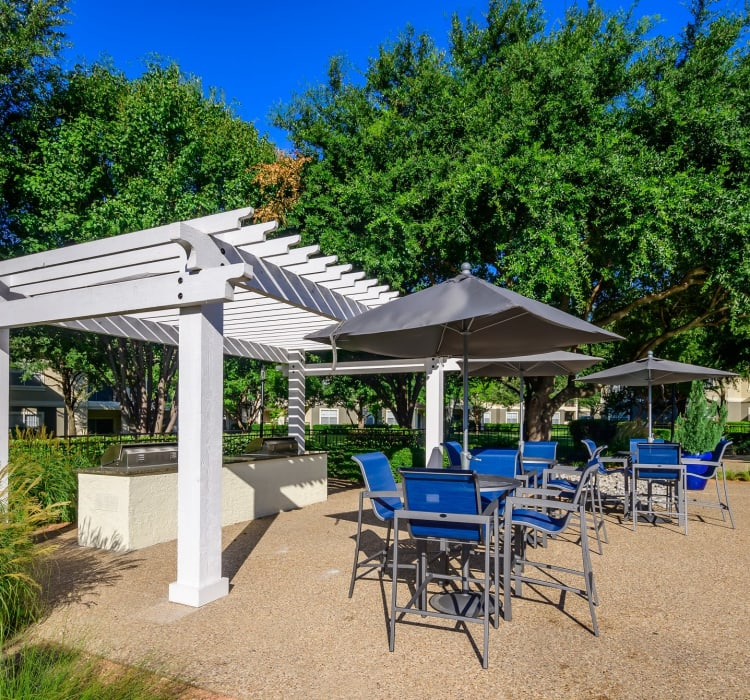 Pergola and shaded seating at the barbecue area with gas grills at 23Hundred @ Ridgeview in Plano, Texas
