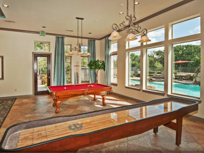 Lavish resident clubhouse with billiards and shuffleboard at The Landing at Mansfield in Mansfield, Texas