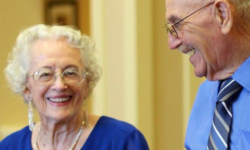 Two residents smiling at a Merrill Gardens community.
