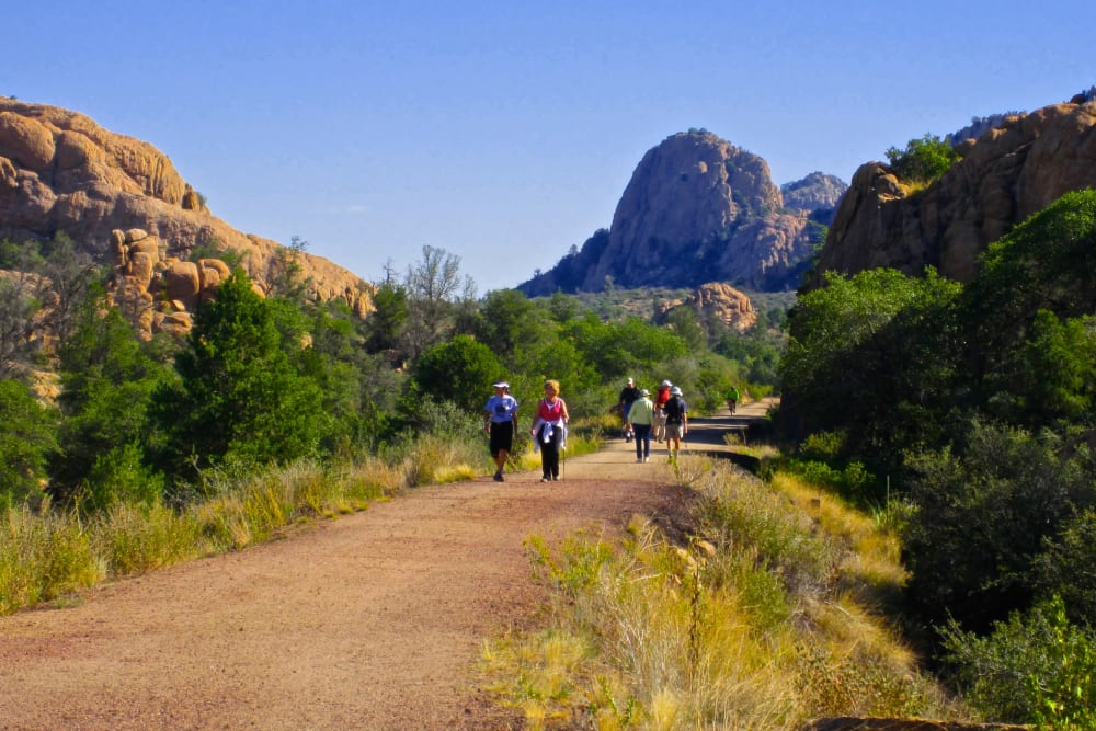 A group of residents from Touchmark at The Ranch in Prescott, Arizona on a hiking trail