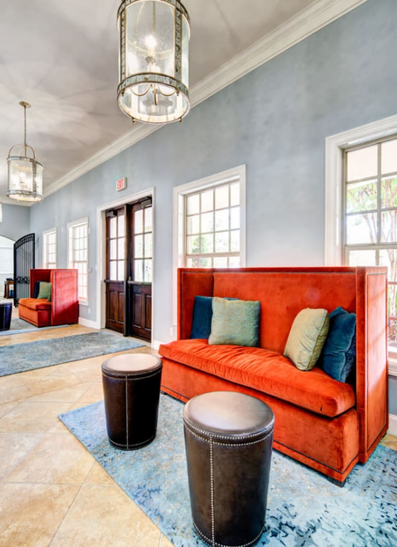 Community clubhouse hallway with sitting areas at Marquis at Silver Oaks in Grapevine, Texas