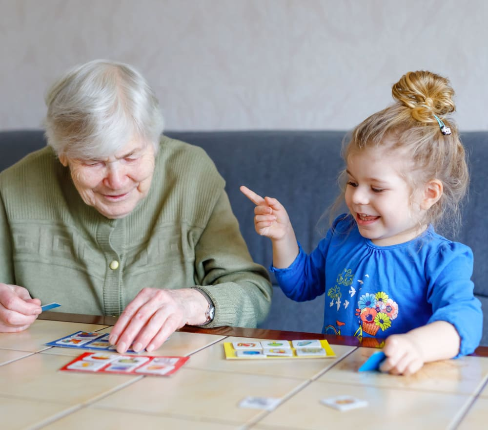 A resident and child playing at Amaran Senior Living in Albuquerque, New Mexico.