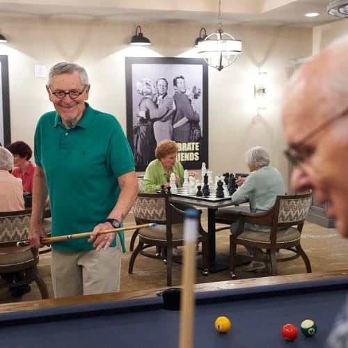 Residents playing pool at Celebration Village Forsyth in Suwanee, Georgia