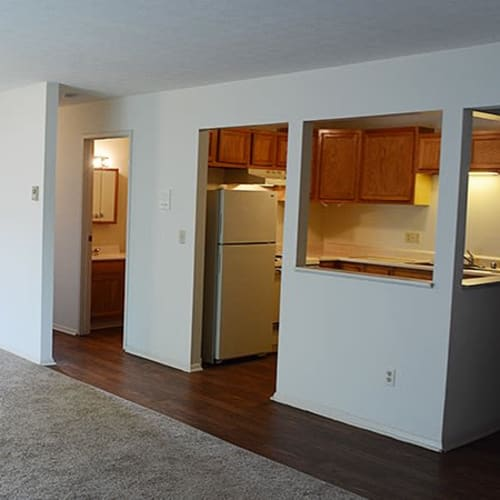 Kitchen pass-through from the living room of an apartment home at Indian Footprints Apartments in Harrison, Ohio