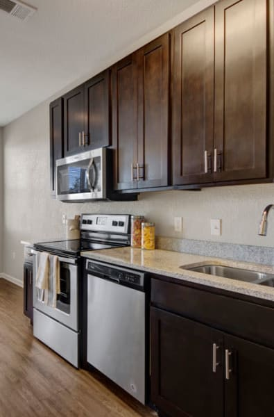 Kitchen with upgraded appliances at Linden on the GreeneWay in Orlando, Florida