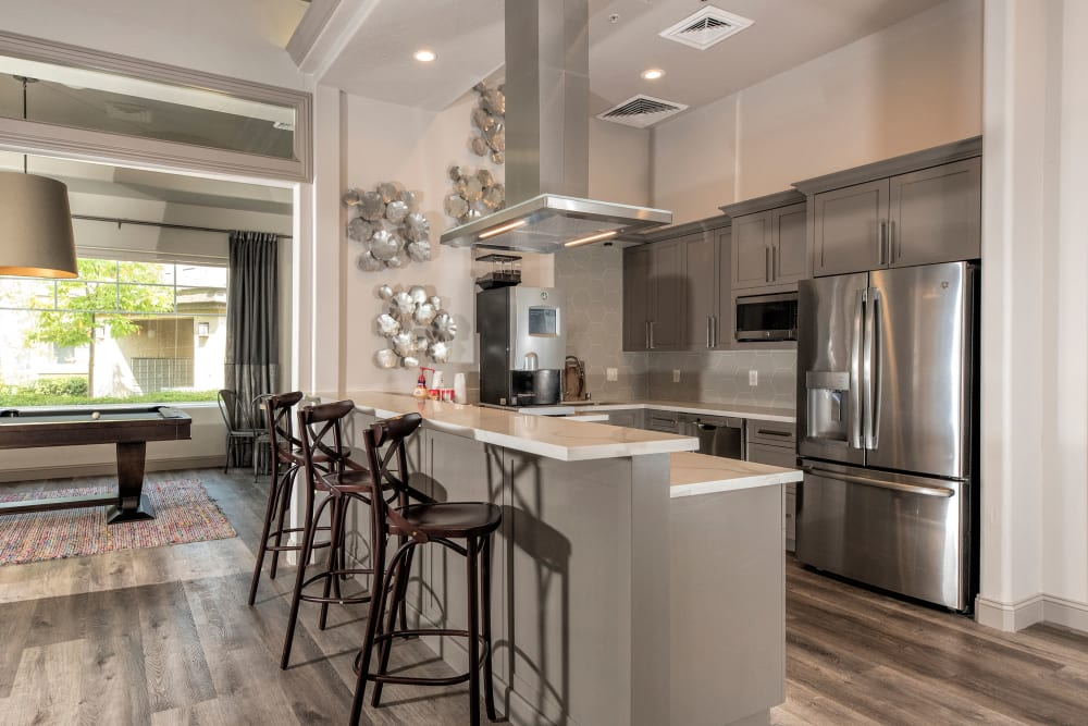 Resident clubhouse with a large community kitchen at The Artisan Apartment Homes in Sacramento, California