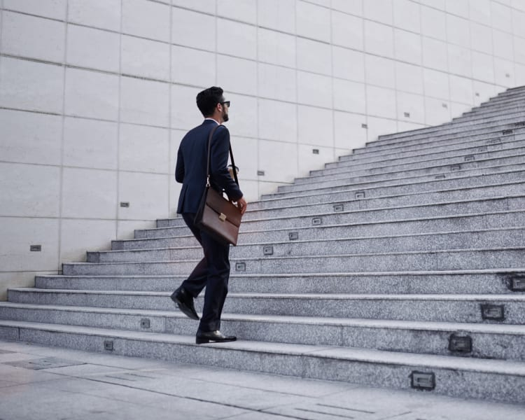Resident walking up the steps to his downtown office near Sofi Warner Center in Woodland Hills, California
