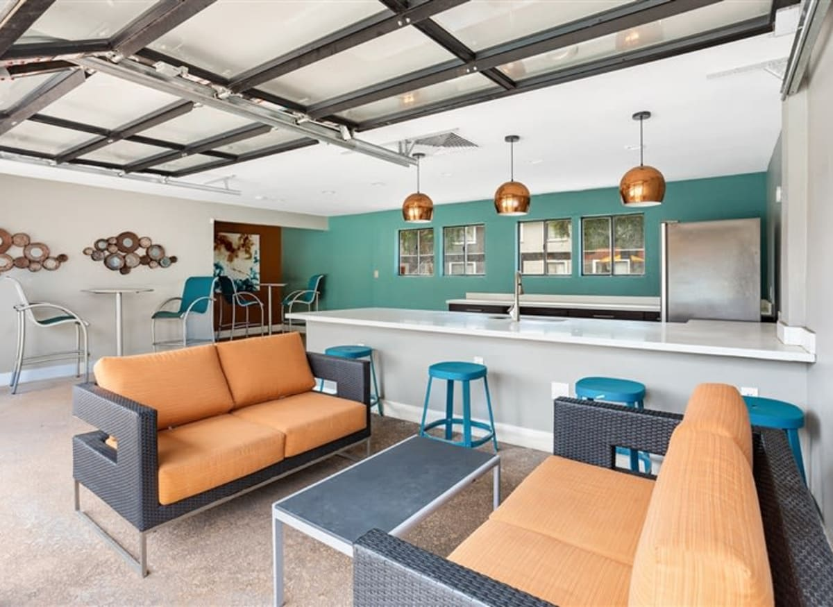 A poolside community kitchen at Argenta Apartments in Mesa, Arizona