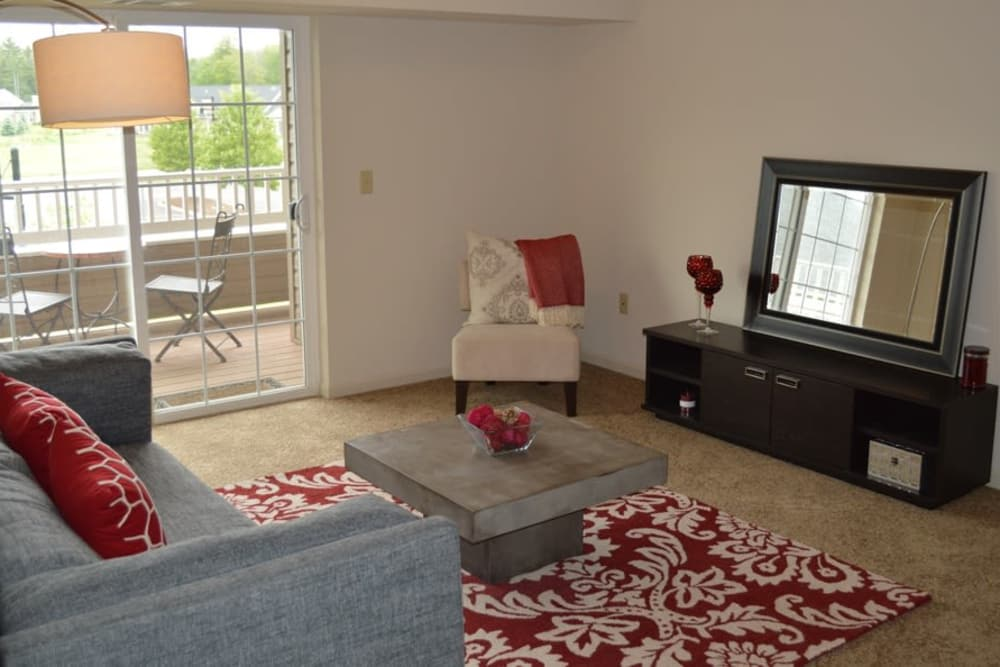 Spacious living room at Greenwood Cove Apartments home in Rochester, NY