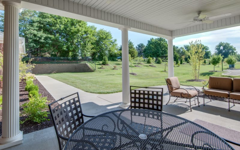 Outdoor patio with chairs at Maplebrook Senior Living in Farmington, Missouri