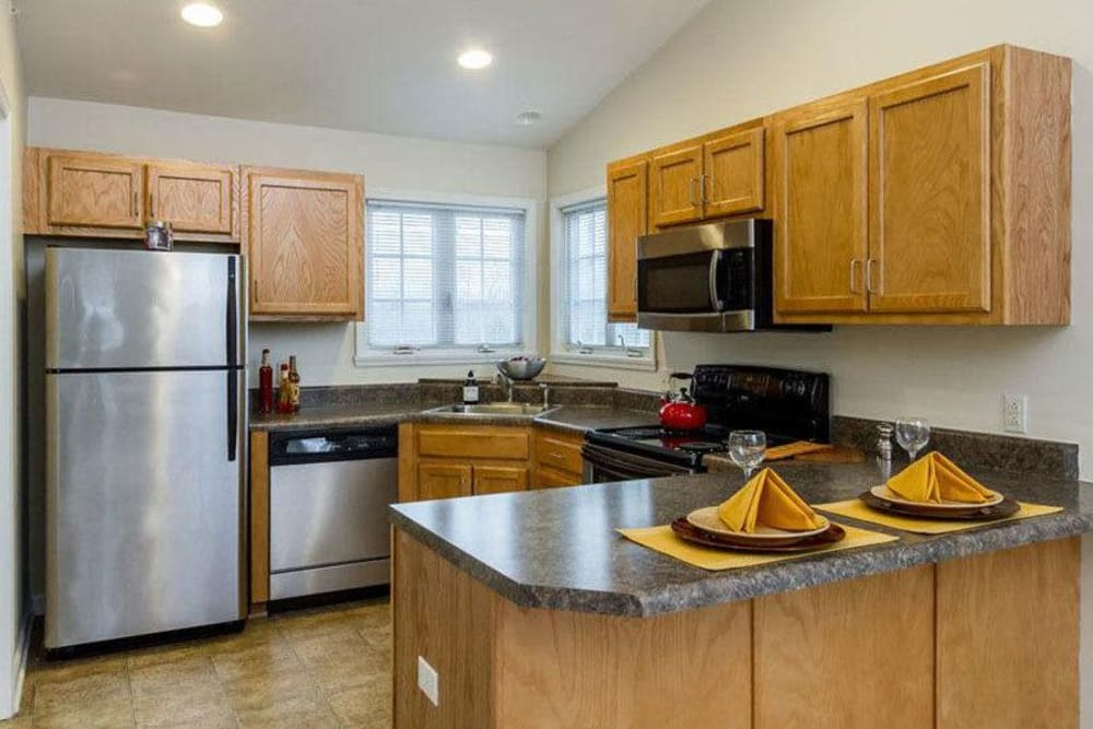Well-equipped kitchen at Villas of Victor and Regency Townhomes in Victor, NY
