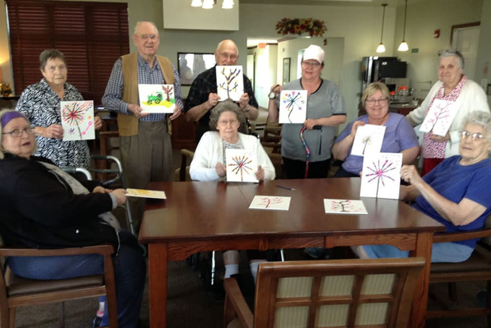 Residents display artwork from painting group at Clover Ridge Place in Maquoketa, Iowa.